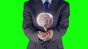 Businessman presenting brain with hands stock video footage