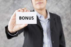 businessman presenting business card with word bonus Royalty Free Stock Images