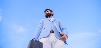 Businessman presenting business case. Business man formal suit carries briefcase sky background. Entrepreneur offer. Bribe. Hipster bearded face hold briefcase stock photography