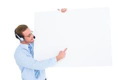 Businessman presenting card wearing headset Stock Photos