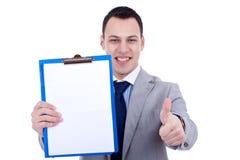 Businessman presenting a clipboard Stock Photos