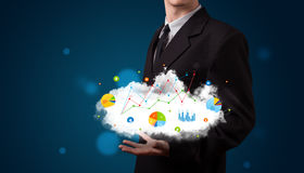 Businessman presenting cloud with charts Stock Image