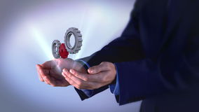 Businessman presenting cogs and wheels graphic stock video footage