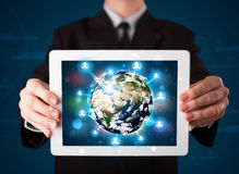 Businessman presenting 3d earth globe in tablet Royalty Free Stock Photo