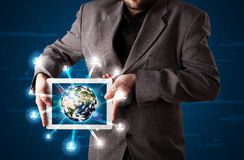 Businessman presenting 3d earth globe in tablet Stock Photo
