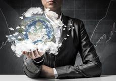 Businessman presenting Earth globe. stock photo
