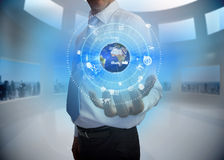 Businessman presenting earth graphic interface Royalty Free Stock Photos