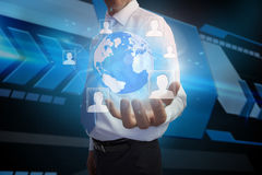Businessman presenting earth with profile pictures Royalty Free Stock Image