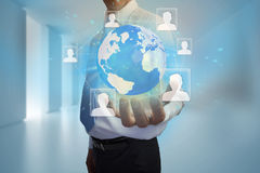 Businessman presenting earth with profile pictures Stock Photography