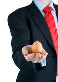 Businessman presenting egg in hand Royalty Free Stock Photo