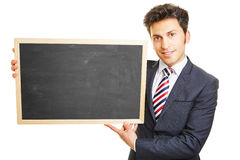 Businessman presenting empty blackboard Stock Image