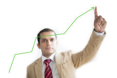 Businessman Presenting Financial growth curve Stock Photography