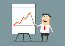 Businessman presenting financial growth on graph Stock Image