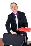 Businessman presenting folder Stock Photos