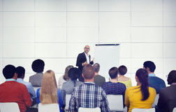 Businessman Presenting in Front of Audience Royalty Free Stock Photo