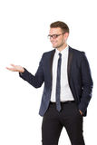 Businessman presenting hand gesture Royalty Free Stock Images