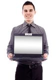 Businessman presenting his laptop Royalty Free Stock Images