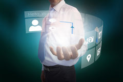 Businessman presenting interface Stock Photos