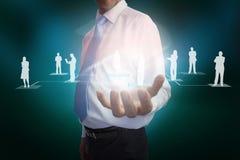 Businessman presenting links between human representations Royalty Free Stock Photo
