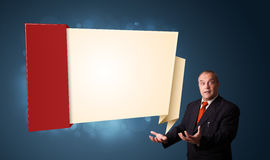 Businessman presenting modern origami copy space Stock Photo
