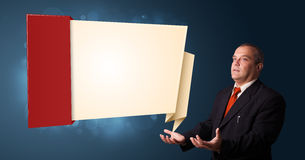 Businessman presenting modern origami copy space Royalty Free Stock Image
