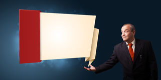 Businessman presenting modern origami copy space Royalty Free Stock Photos