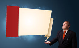 Businessman presenting modern origami copy space Royalty Free Stock Photography