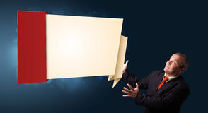Businessman presenting modern origami copy space Stock Photography