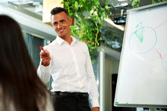 Businessman presenting a new strategy to his Stock Photos