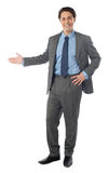 Businessman presenting over white background Royalty Free Stock Photography