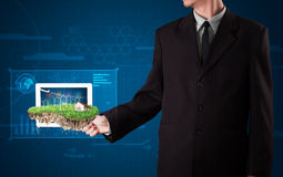 Businessman presenting a perfect ecology land with a house and w Royalty Free Stock Photography