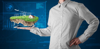 Businessman presenting a perfect ecology land with a house and w Royalty Free Stock Image