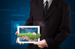 Businessman presenting a perfect ecology land with a house and w Royalty Free Stock Photo