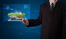 Businessman presenting a perfect ecology land with a house and w Royalty Free Stock Images