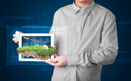 Businessman presenting a perfect ecology land Royalty Free Stock Photo