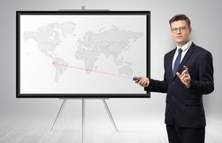 Businessman presenting potential business area on map royalty free stock images