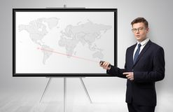Businessman presenting potential business area on map royalty free stock image