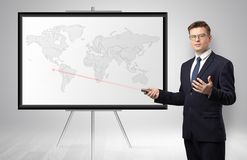 Businessman presenting potential business area on map stock photos