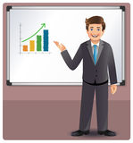 Businessman presenting profits on a whiteboard Royalty Free Stock Image