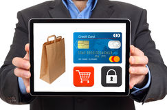 Businessman presenting  safe shopping in a digital tablet Stock Photo