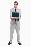 Businessman presenting screen of his laptop Stock Photography