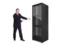 Businessman presenting server rack stock photos