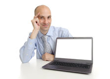 Businessman presenting somenting on a laptop screen Stock Images