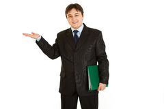 Businessman presenting something on empty hand Royalty Free Stock Photography