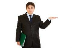 Businessman presenting something on empty hand Stock Photo