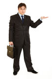 Businessman presenting something on empty hand Stock Photography