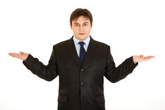 Businessman presenting something on empty hands Stock Photography