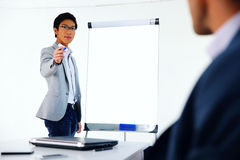 Businessman presenting something on a meeting Royalty Free Stock Photography