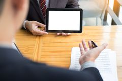 Businessman presenting something at the seminar using tablet at. The office, Audit concept at working Royalty Free Stock Images