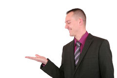 Businessman presenting something with a smile Royalty Free Stock Images